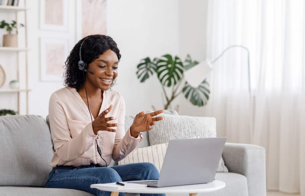 Video,Conference.,Smiling,African,Woman,Having,Web,Call,On,Laptop